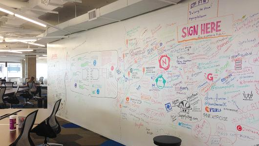 A graffiti wall that is common corporate space at a tech incubator in Crystal City, Va.